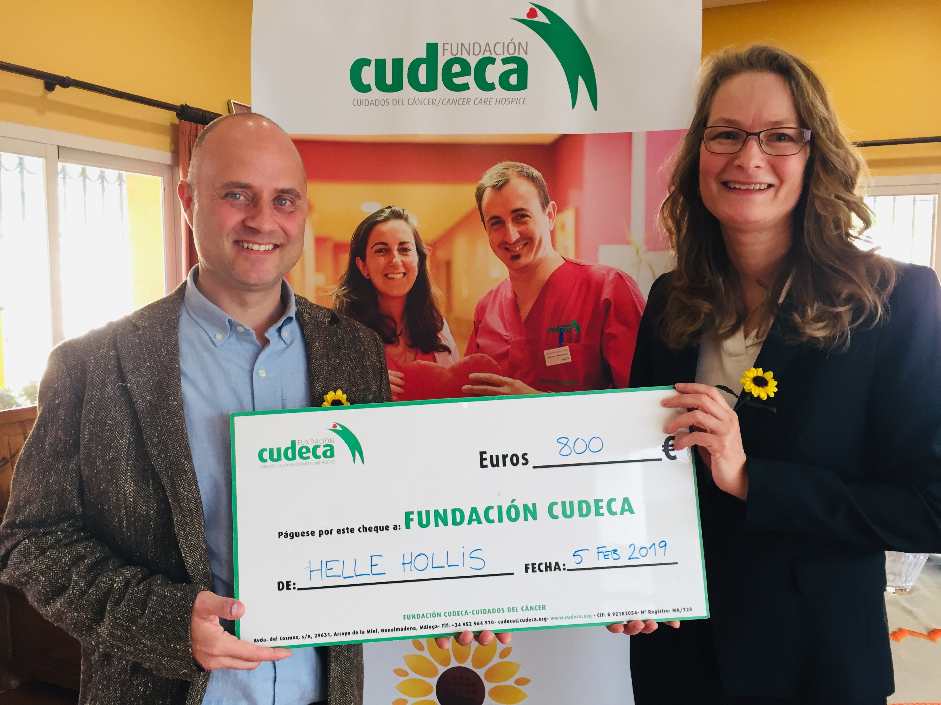 Helle Hollis presents cheque donation after 9 years helping CUDECA!